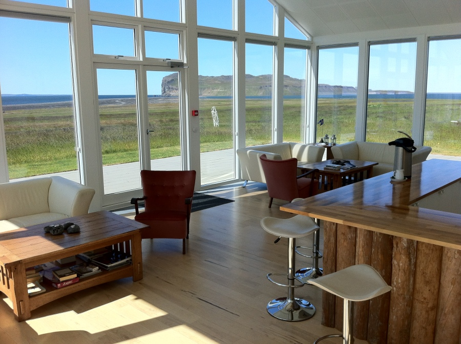 .. to the glass common room with kitchen facing out on the fjord.