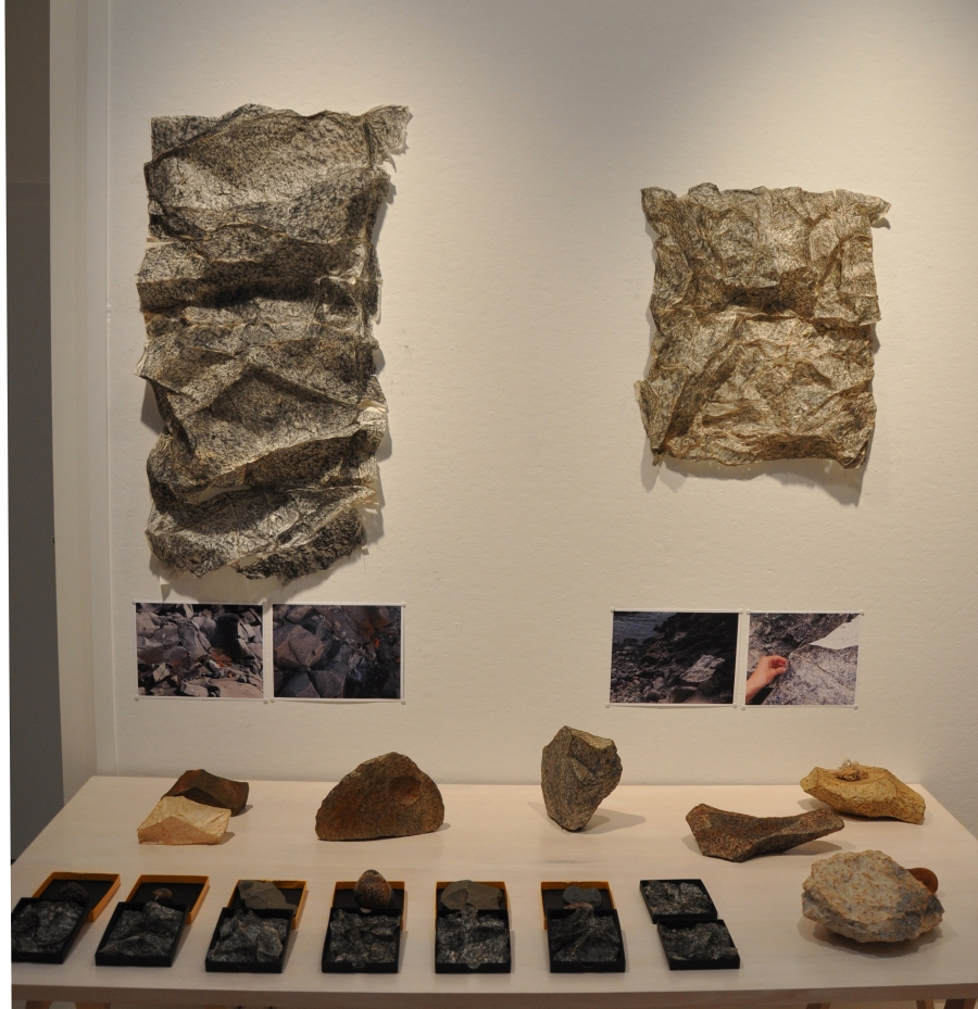 Diana's intriguing nature table including her paper-wrapped rocks and flayed rock skins.